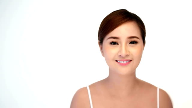 Beautiful healthy smiling woman with fresh skin of face over white background.