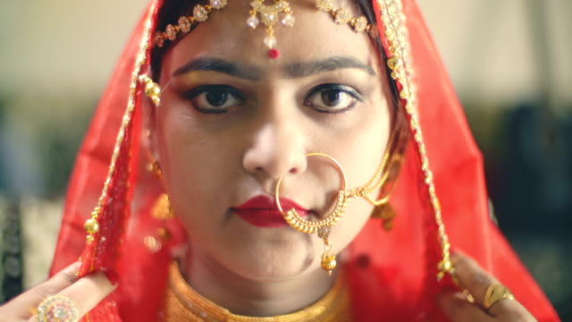 beautiful hindu bride in traditional dress looks at the camera. - married stock videos & royalty-free footage