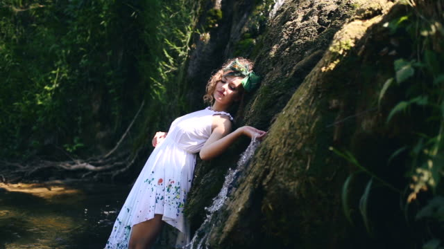 Beautiful hippie girl posing in nature
