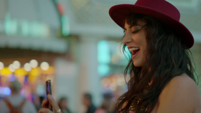 beautiful hipster woman takes a photo of her friends on fremont st. in las vegas - millionnaire stock videos & royalty-free footage