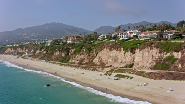 aerial beautiful homes on a cliff in malibu - coastline stock videos & royalty-free footage