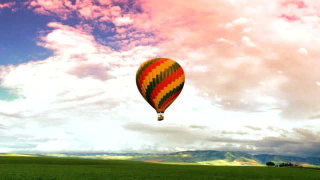 beautiful hot air balloon on a cloudy background - hot air balloon stock videos & royalty-free footage