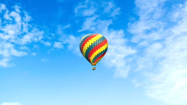 beautiful hot air balloon on a cloudy background - balloon stock videos & royalty-free footage