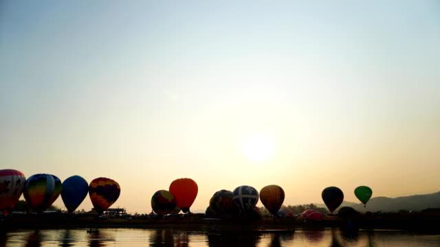 beautiful hot air balloons at sunset. - historical reenactment stock videos & royalty-free footage