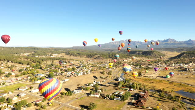 Beautiful Hot Air Balloons Floating Above City in Colorado