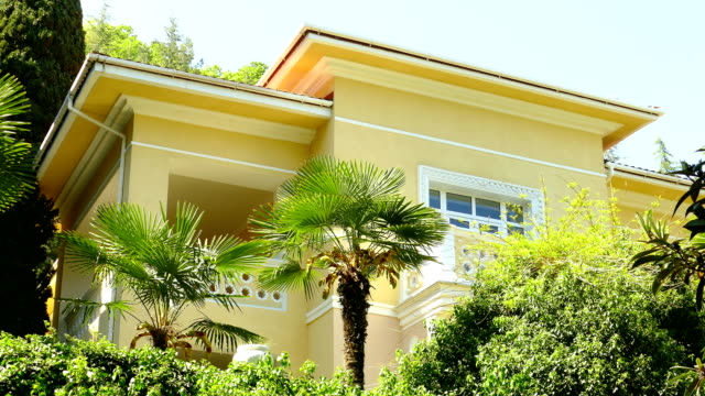 beautiful house with palm trees - bungalow stock videos and b-roll footage