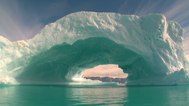 Beautiful huge iceberg with a hole Greenland