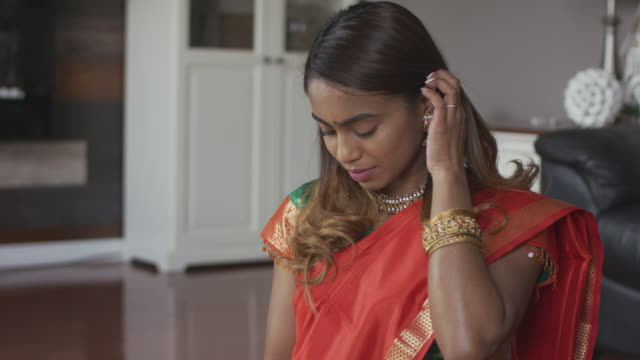 beautiful indian female at home - sari stock videos & royalty-free footage