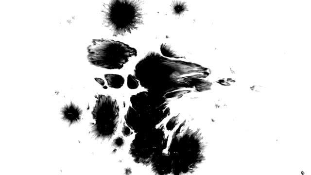beautiful ink splashes scatter across the white surface - splashing droplet stock videos and b-roll footage