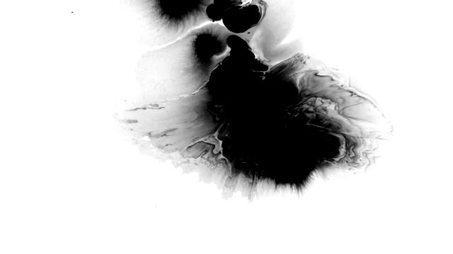 beautiful ink splashes scatter across the white surface - macchiato video stock e b–roll