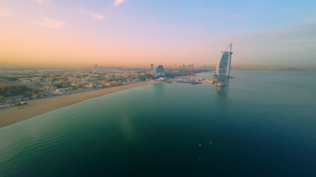 aerial beautiful jumeirah beach with burj al arab hotel - helicopter point of view stock videos & royalty-free footage