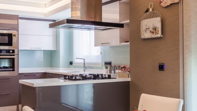 beautiful kitchen in new luxury home - kitchen worktop stock videos & royalty-free footage