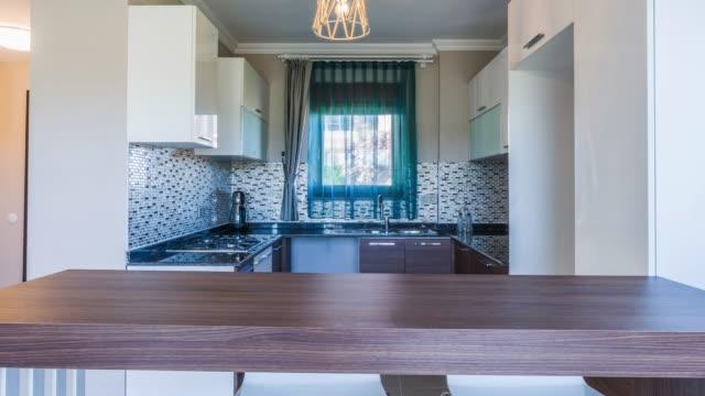 beautiful kitchen in new luxury home - kitchen worktop stock videos & royalty-free footage