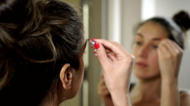 beautiful lady drawing eyebrows - eyebrow stock videos & royalty-free footage