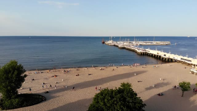 beautiful landscape video of sopot seaport (pier in sopot / molo w sopocie) in poland by drone camera. - poland stock videos & royalty-free footage