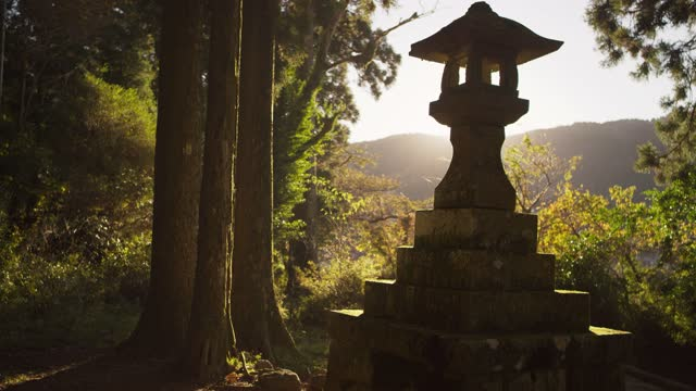 beautiful lantern statue next to lake in japanese forest - mt fuji stock videos & royalty-free footage