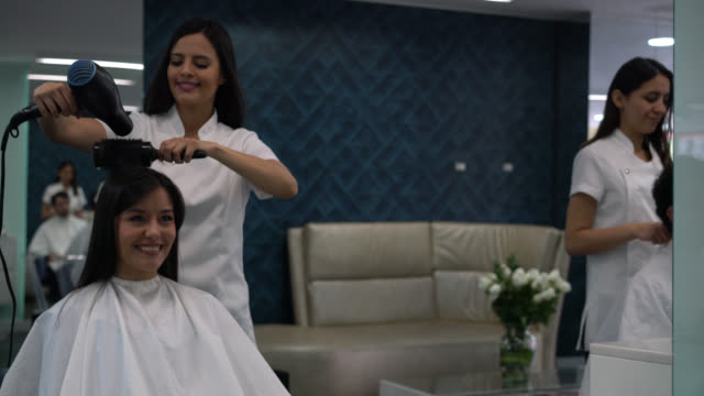 beautiful latin american woman at the hair salon getting a hairdo looking very happy at the mirror - hairstyle stock videos & royalty-free footage