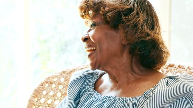 beautiful laughing senior african american woman - widow stock videos & royalty-free footage