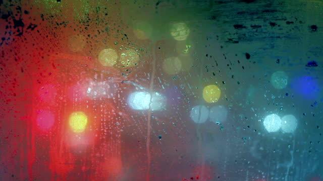 Beautiful lights moving under the rain