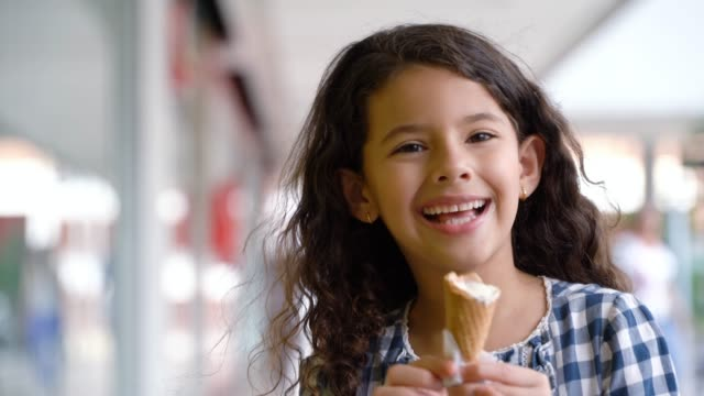 beautiful little girl enjoying a delicious ice cream at the mall - ice cream stock videos & royalty-free footage