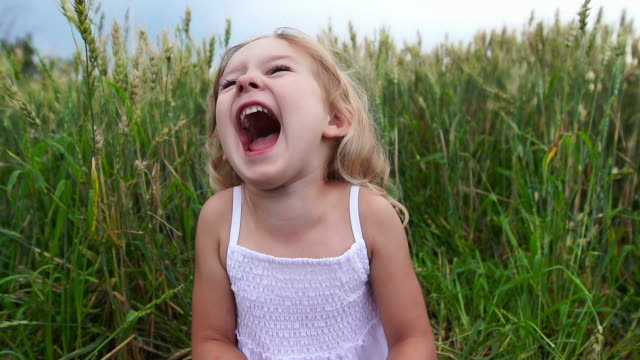 beautiful little girl laughs - laughing stock videos & royalty-free footage