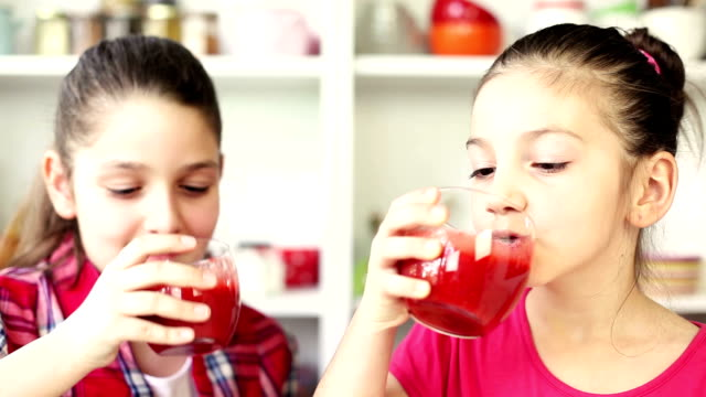 beautiful little girls drinking a strawberry smoothie - smoothie stock videos & royalty-free footage