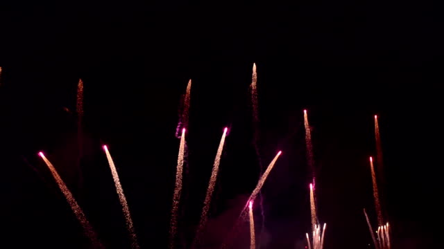 beautiful low attitude firework blooming - moving up stock videos & royalty-free footage