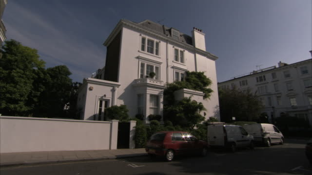 beautiful lush trees surround a flat in london england. available in hd. - erkerfenster stock-videos und b-roll-filmmaterial