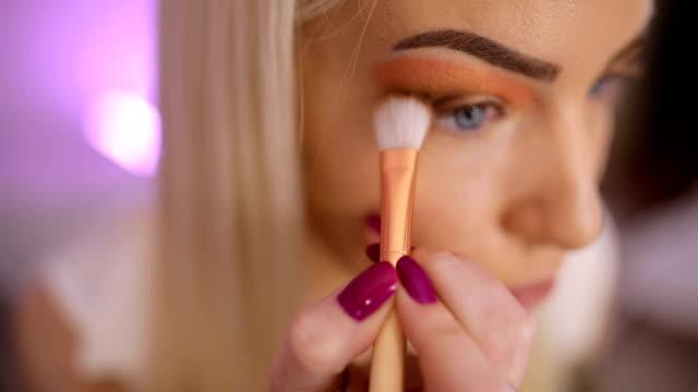 beautiful make-up artist woman applying make up on eyes - side hustle stock videos & royalty-free footage