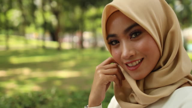 beautiful malaysian woman with green eyes in the park - green eyes stock videos and b-roll footage