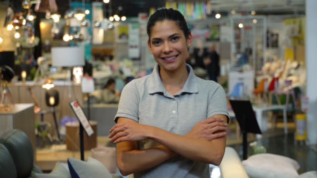 beautiful manager of a furniture store crossing her arms smiling at camera - retail occupation stock videos & royalty-free footage