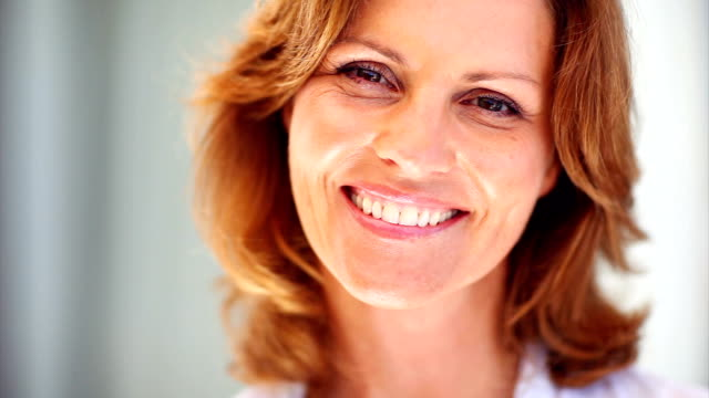 beautiful mature female smiling - mature adult stock videos & royalty-free footage
