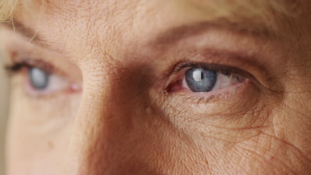 Beautiful mature woman blue eyes closeup