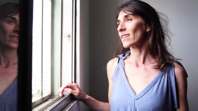 beautiful mature woman looking out of window - pardo brazilian stock videos & royalty-free footage