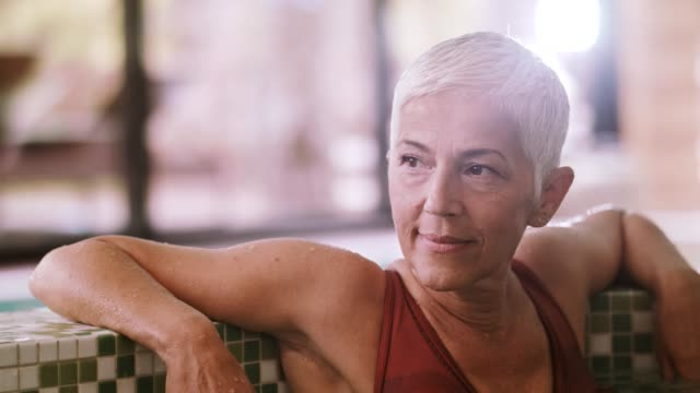 beautiful mature woman relaxing in hot tub - short hair stock videos & royalty-free footage