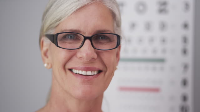 Beautiful mature woman wearing prescription eyeglasses