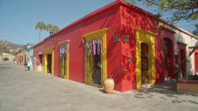 beautiful mexican red colonial style house at oaxaca de juarez - corner stock videos & royalty-free footage