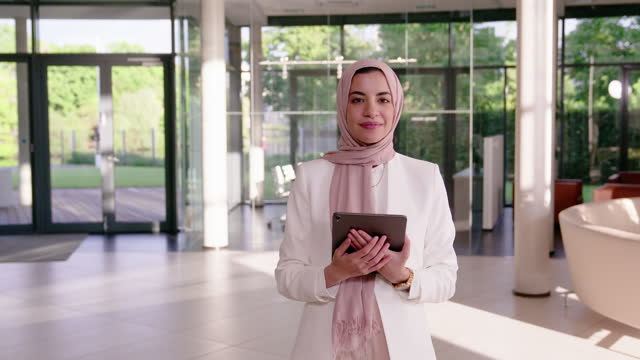 beautiful middle eastern woman with headscarf holding digital tablet - hijab stock videos & royalty-free footage
