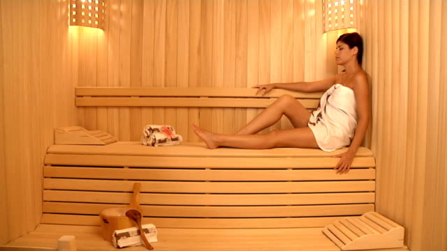 beautiful model in sauna - sauna stock videos and b-roll footage