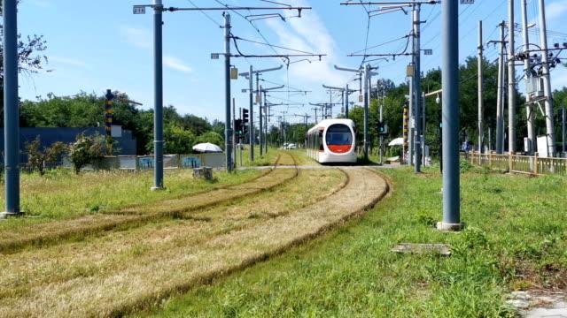 beautiful modern tram running in beijing - public transport stock videos & royalty-free footage