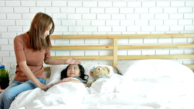 Beautiful Mother Waking Up Her Daughter From Nightmare