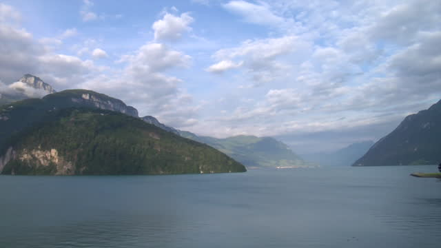 beautiful mountain vista featuring lake lucerne surrounded by mountains, sky and clouds. - lake lucerne stock videos & royalty-free footage