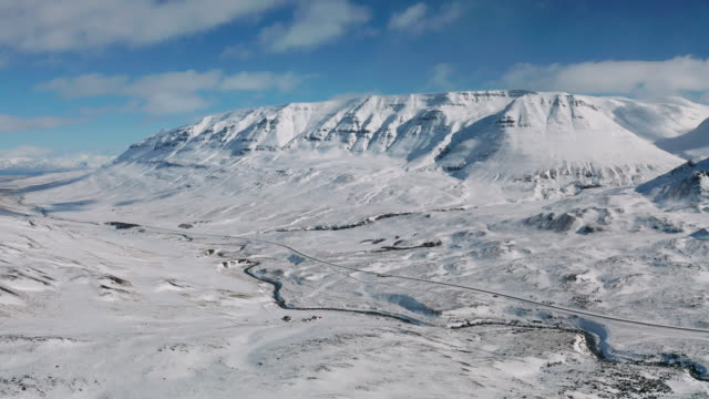 beautiful mountain winter landscape near akureyri, iceland - 深い雪点の映像素材/bロール