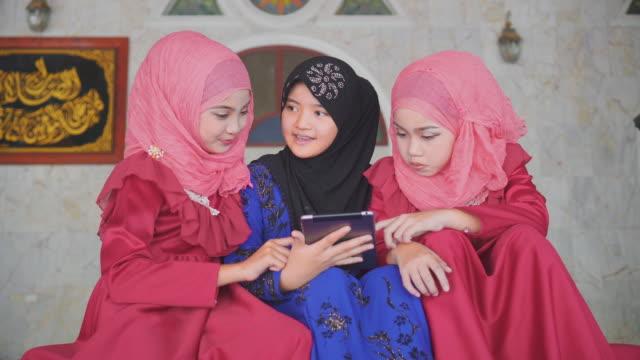 beautiful muslim girl using digital tablet - dolly shot stock videos & royalty-free footage