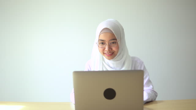 beautiful muslim woman study with computer laptop - hijab stock videos & royalty-free footage