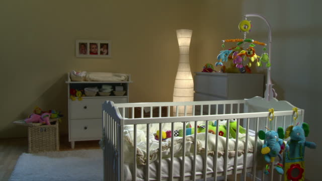 hd: beautiful nursery room at night - nursery bedroom stock videos & royalty-free footage