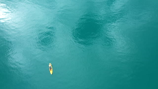 beautiful ocean and floating kayak - water surface level stock videos & royalty-free footage