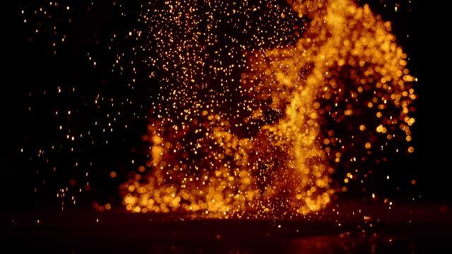 slo mo ld beautiful orange sparks against black background - orange colour stock videos & royalty-free footage