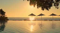Beautiful outdoor swimming pool in hotel resort nearly sea ocean side for travel vacation