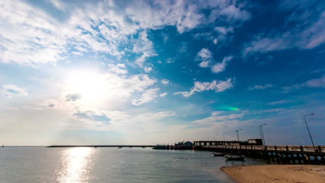 beautiful pier in ocean with sun and cloud in the sky - pier stock videos & royalty-free footage